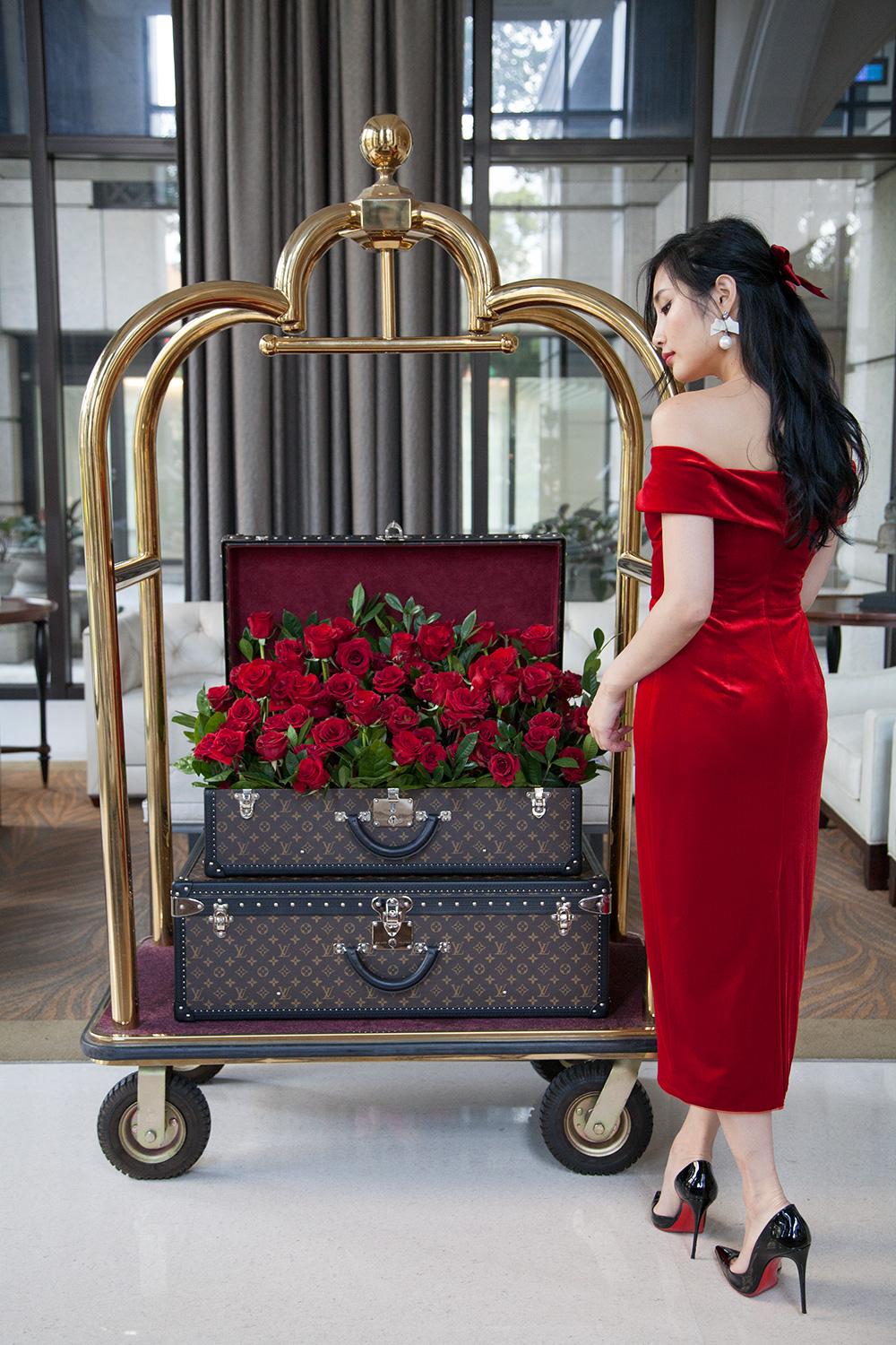 9 Days of Valentine - Day 2: Read Romance Novels | Of Leather and Lace - Fashion & Travel Blog by Tina Lee | red dress outfit, valentines outfit ideas, red soles, christian louboutin, louis vuitton trunk, red roses, romantic outfits, hotel trolley